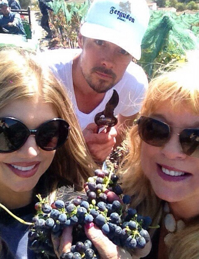 Fergie e Josh Duhamel fazem vindima